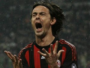 AC Milan's Filippo Inzaghi reacts after missing a goal opportunity against Reggina during their Italian Serie A soccer match at the San siro stadium in Milan February 7, 2009. REUTERS/Alessandro Garofalo. (ITALY)